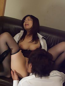 Asian housewife takes two dicks in her mouth and pussy