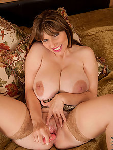 Busty milf plows her pussy with a dildo