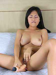 Asian Babe Flashes and Squeeze Her Big Boobs