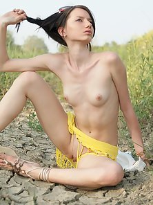 Sexy Slut Sitting Nakedly on Sand and Exposing Small Tits