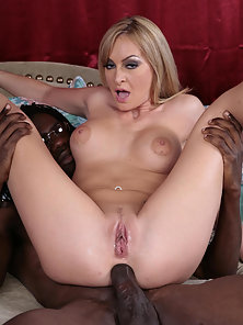 Big boobed blonde dares to take big black cock in the ass