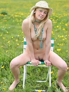 Sexy Blonde Sitting on Chair Exposing Fabulous Sexual Parts