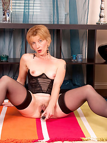 Blonde Granny Looks Attractive Wearing Black Lingerie