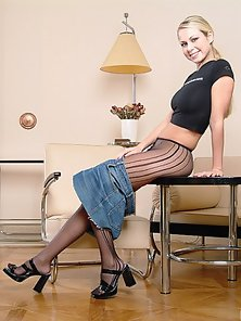 Blonde Teen Lower Her Jeans Skirt and Shows Her Pantyhose