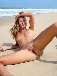 Stunning beautiful amateur girl outdoors on the beach