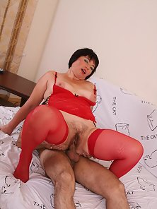 Horny chubby milf in red stockings and lingerie gets hairy cunt slammed