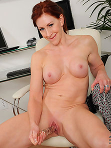 Catherine Desade rams a dildo up her horny pussy