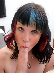Cute babe with colourful hair gets facialized