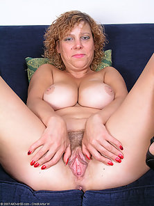 Older blonde milf showing her hairy cunt on the couch
