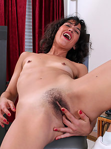 Mature lady works out and fingers her hairy twat