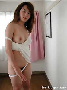 Horny Asian babe gets her hairy pussy out