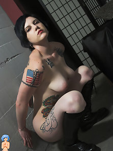 Naked girl covered with tattoos posing