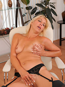 Hot lingerie milf touching her wet cunt