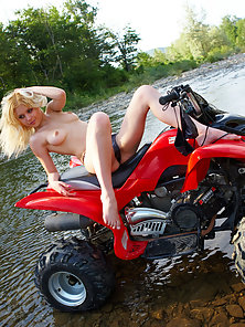 Incredibly Hot Blonde Showing with Sports Bike Outdoor