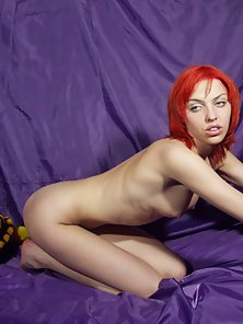 Natural Tits Red Head Babe Shows Her Striptease Activity Indoors