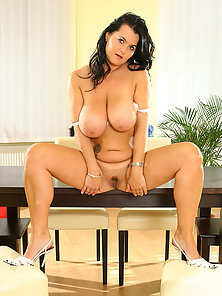 Black haired MILF with massive boobs strips her panties and craves for dick