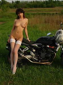 Hot Lady Sitting beside Bike Giving Naughty Poses Outdoors