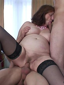 Busty Granny Gets Squeezing and Penetrated by Two Hunky Guys