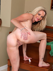 Busty milf Cassy Torri strips and plays with toys