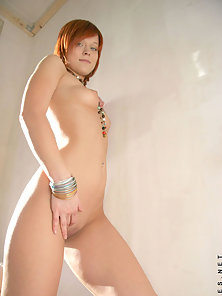 Redhead Girl Display Her Small Boobs and Shaved Muff