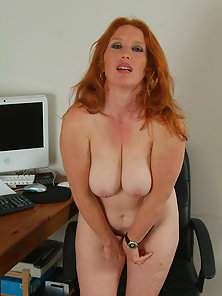 Redheaded Rose plays around with her hairy pussy at the office