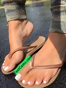 Gorgeous pedicured feet in flipflops