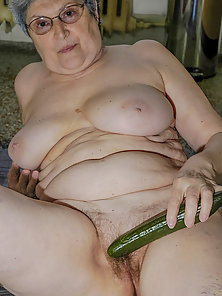 Grandma filling her pleasure hole while horny