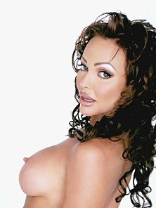 Brunette Curly Haired Babe Shows Her Puffy Boobs on Webcam