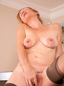 Mature Lady in Stocking Stripped Dress and Showing Muff