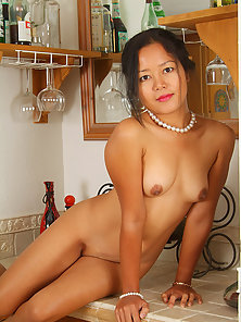 Elegant Adena strips her black dress and spreads her legs in the kitchen