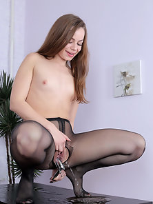 Sizzling Girl in Black Pantyhose Rubbing Pussy for Solo Satisfaction