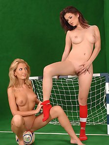 Two soccer players are enjoying themselves on the field