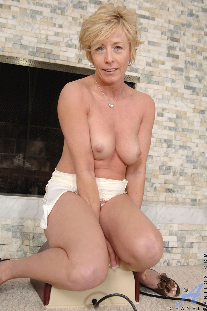 The hot milf riding a huge toy really