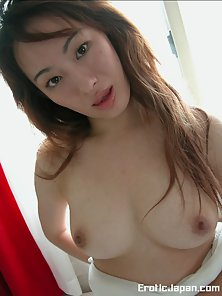 Horny Asian babe shows us her nice big boobs