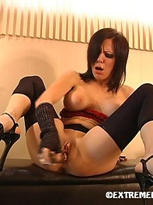 Horny babe stuffing huge glass dildo in juicy cunt