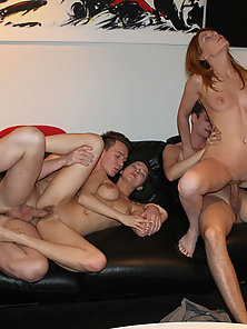Two innocent beauties are having foursome on the couch