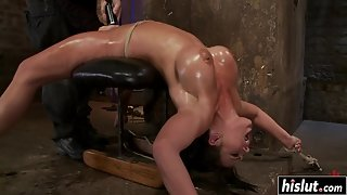 Oiled up girl gets her cunt punished