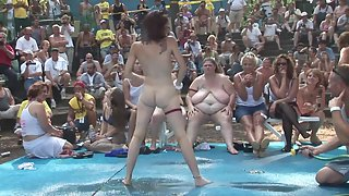 Naked girls showing huge boobs to many people outdoors
