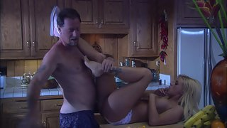Husband fucks blonde wife in the kitchen