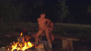 Hot couple enjoys sex by the campfire