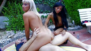Tempting babes get banged in outdoor threesome