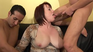 Chubby Lady Hungrily Sucking Two Meaty Dicks Indoors
