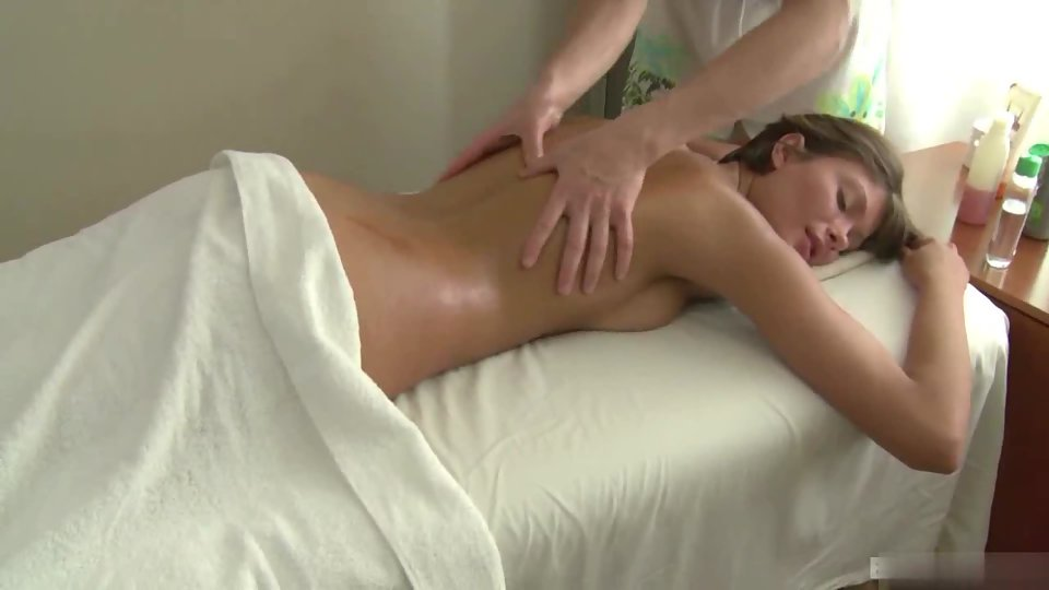 Hot Girl Laying Over Bed and Taking Fabulous Body Massage Form Masseur