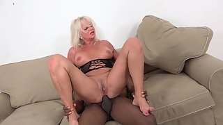 Mature blonde's pussy enjoys some black meat