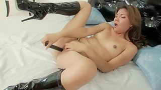 Skinny lonely Asian makes her pussy wet with a toy