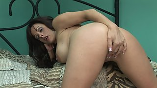 Big breasted MILF makes her pussy wet with toy