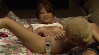 Sexy Asian chick getting off with various sex toys