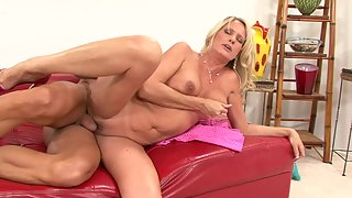 Mature slut gets fucked on a red couch