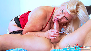 Busty blonde mature takes care of big long shaft