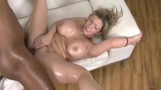 Oiled up babe blonde takes a monster black cock